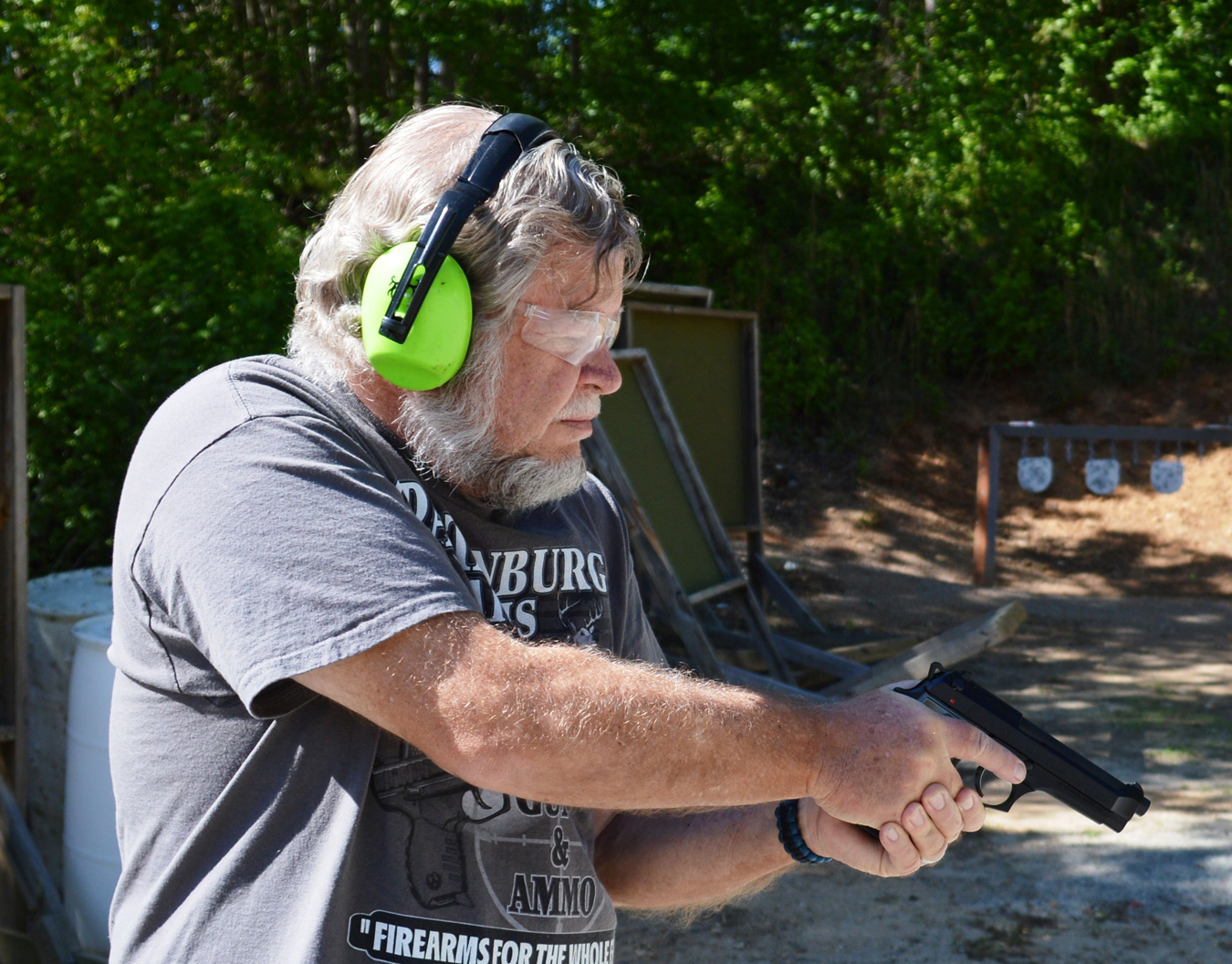 Bob Campbell holding the Beretta 92 pistol at a low ready