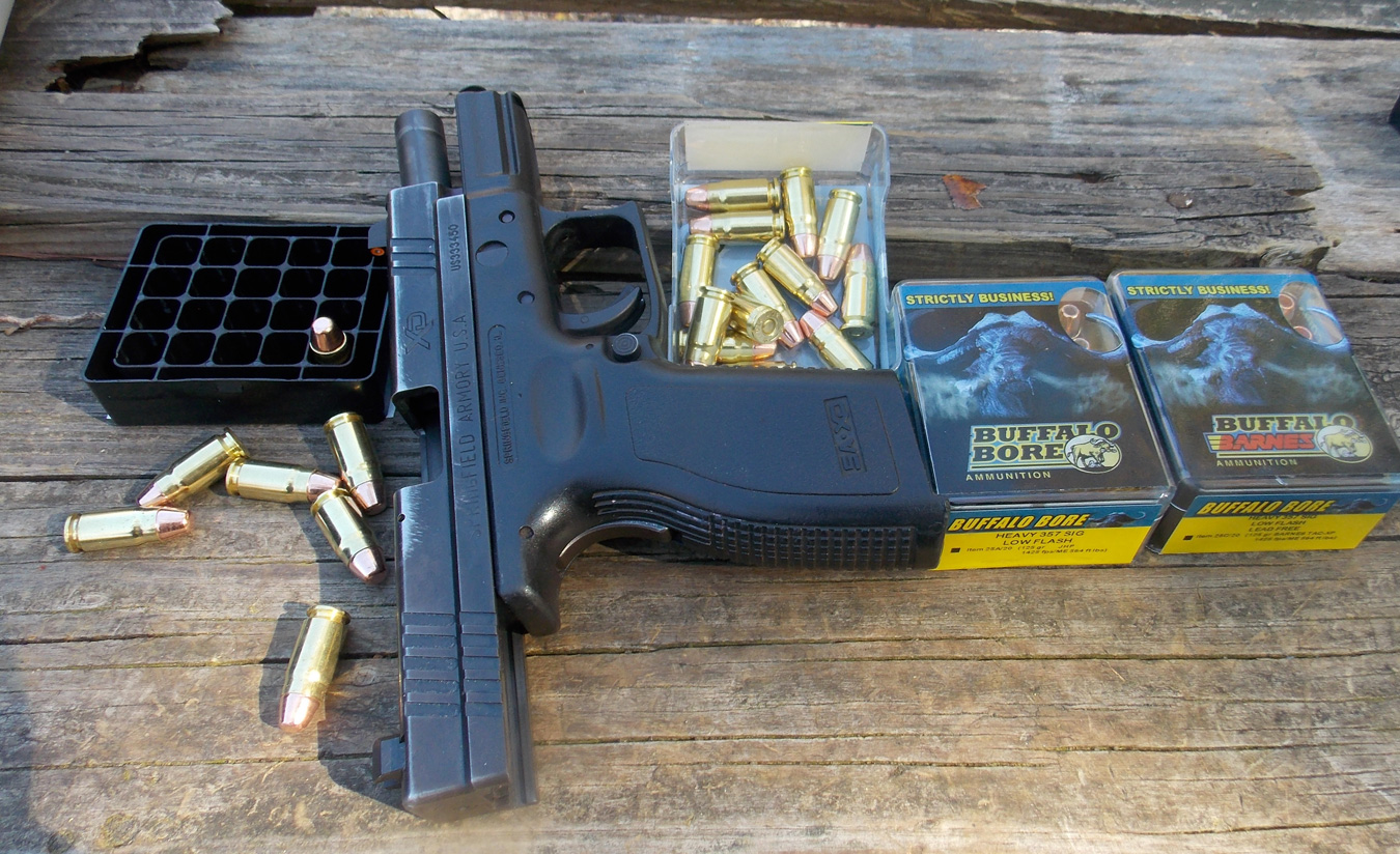Springfield XD pistol with a box of Buffalo Bore ammunition