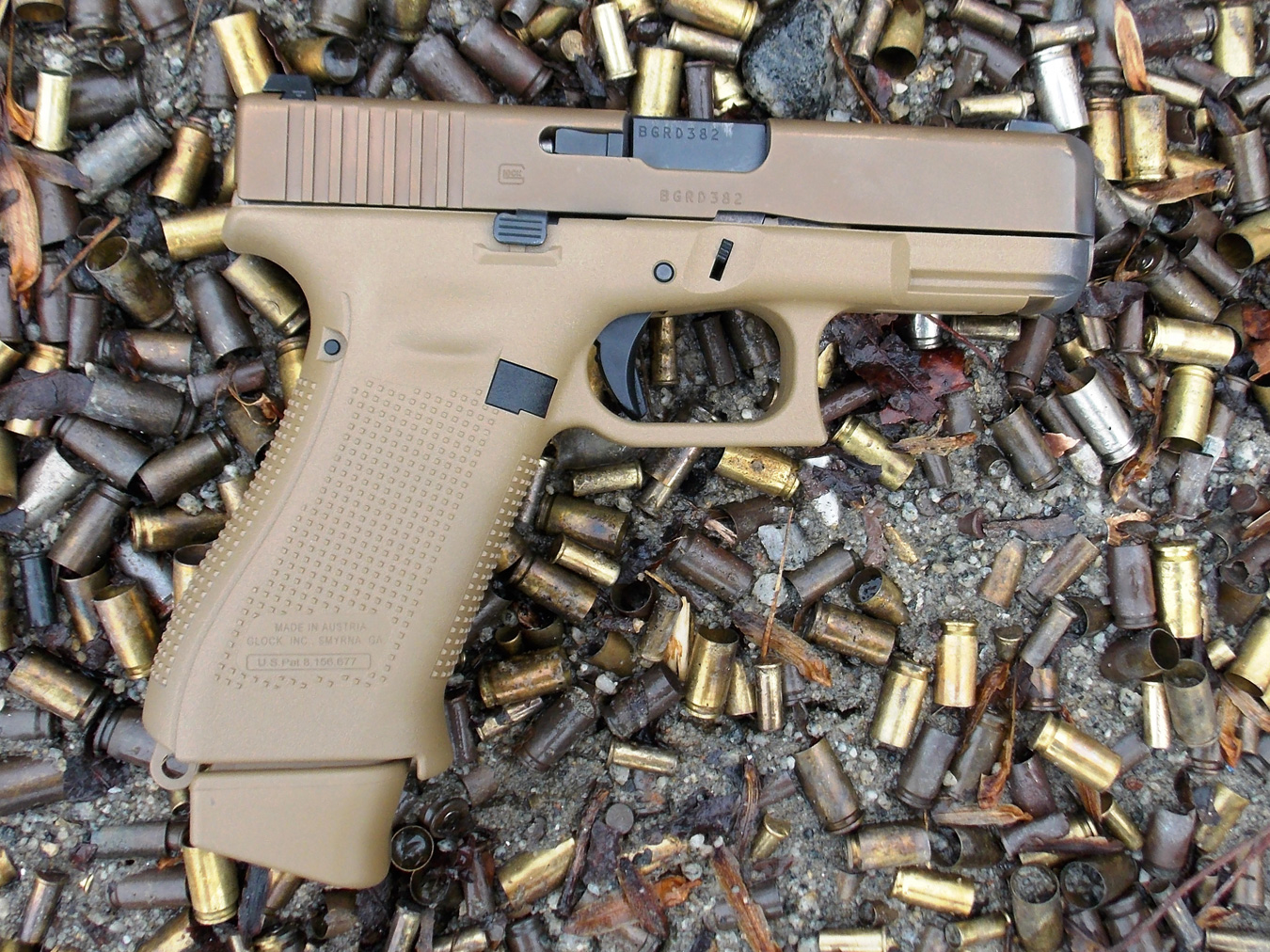 Glock 19x profile right on a bed of spent cartridge cases