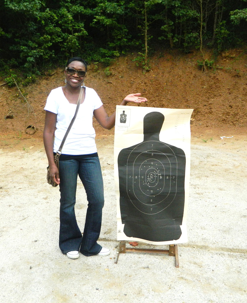 woman standing next to a silhouette target