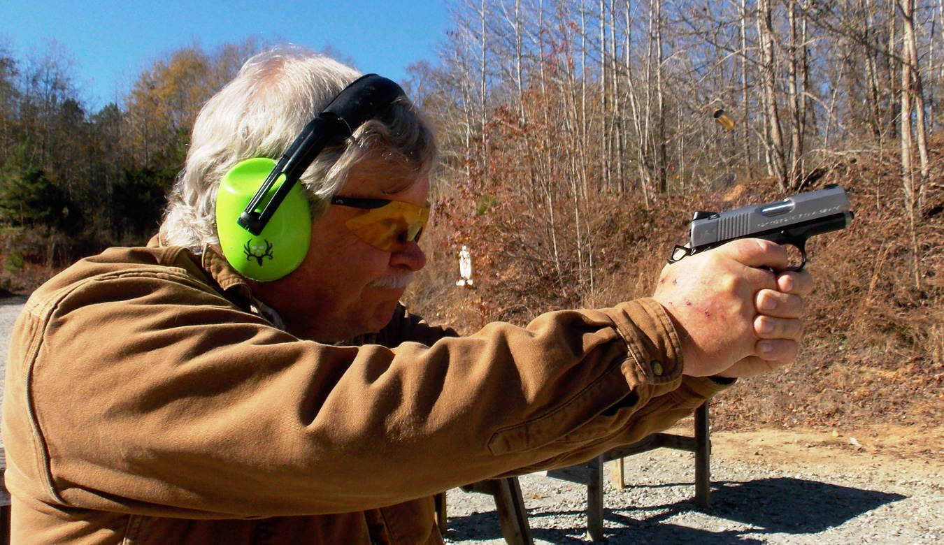 Bob Campbell shooting the Springfield EMP 1911 pistol during recoil