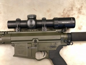 "The Tactical version of the Mod7 1-8X is designed with a first focal plane reticle- allowing the scope to be used as a ""red dot"" at 1x but full and easy use of mil dots at range."