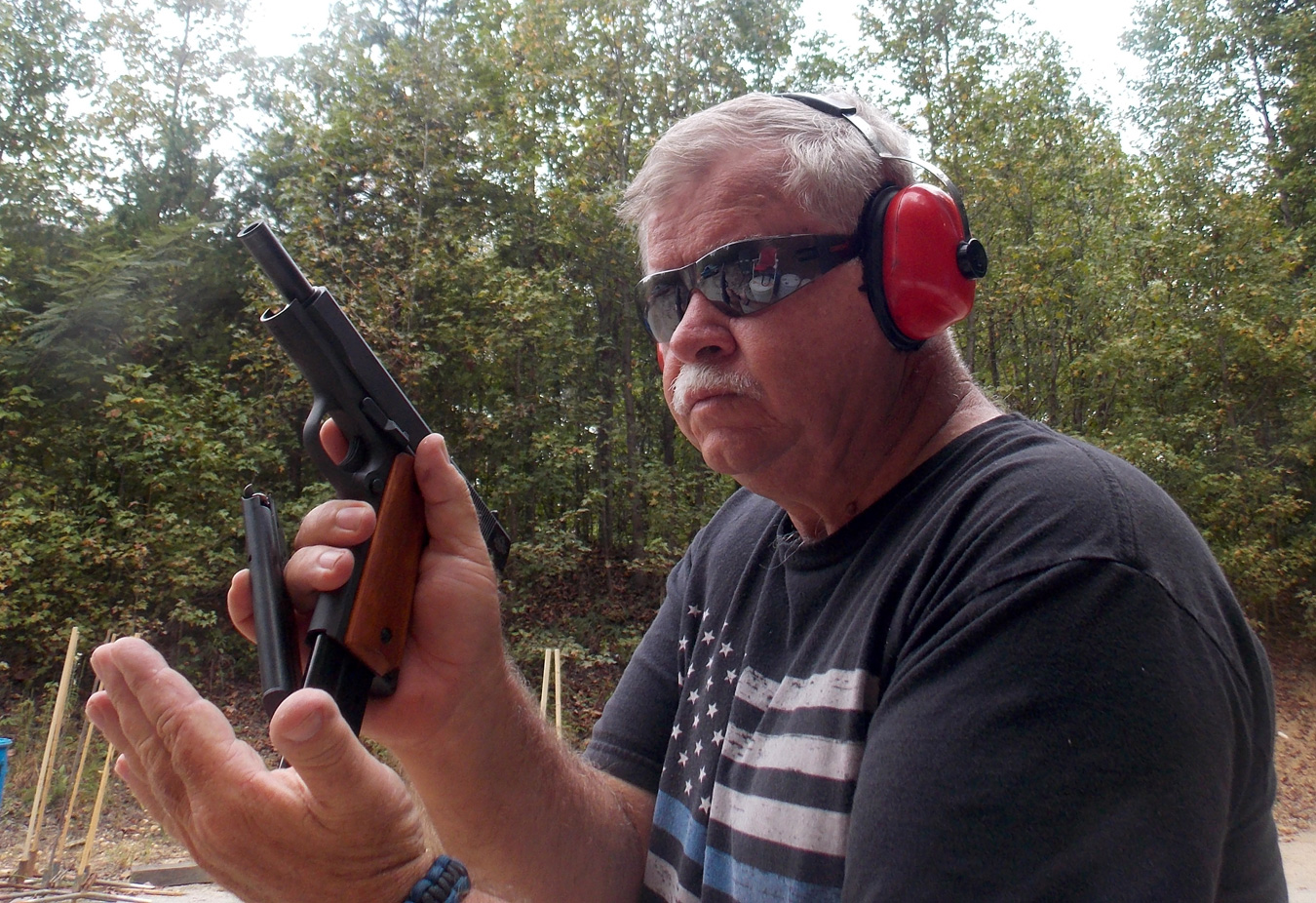 Inserting a magazine into a 1911 pistol