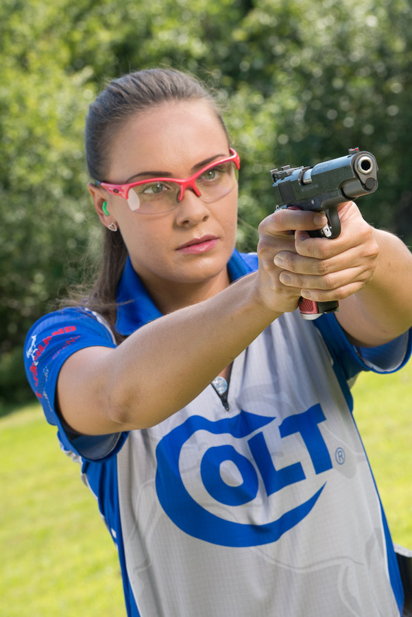 Maggie Reese shooting a Colt 1911 competition pistol