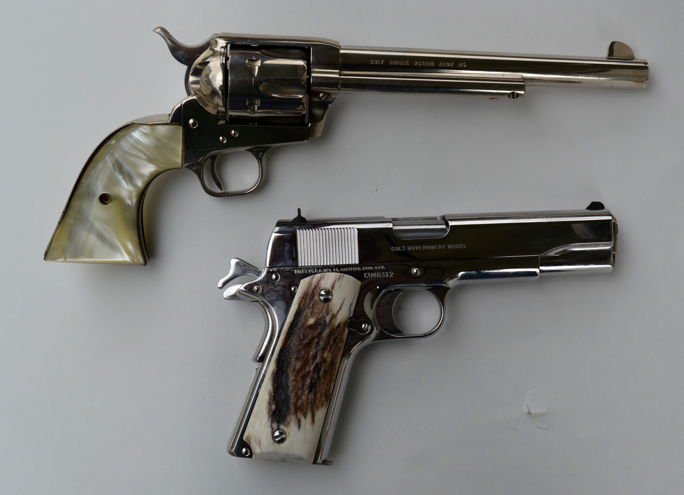 Colt Single Action Army, top and Colt Government model 1911 bottom