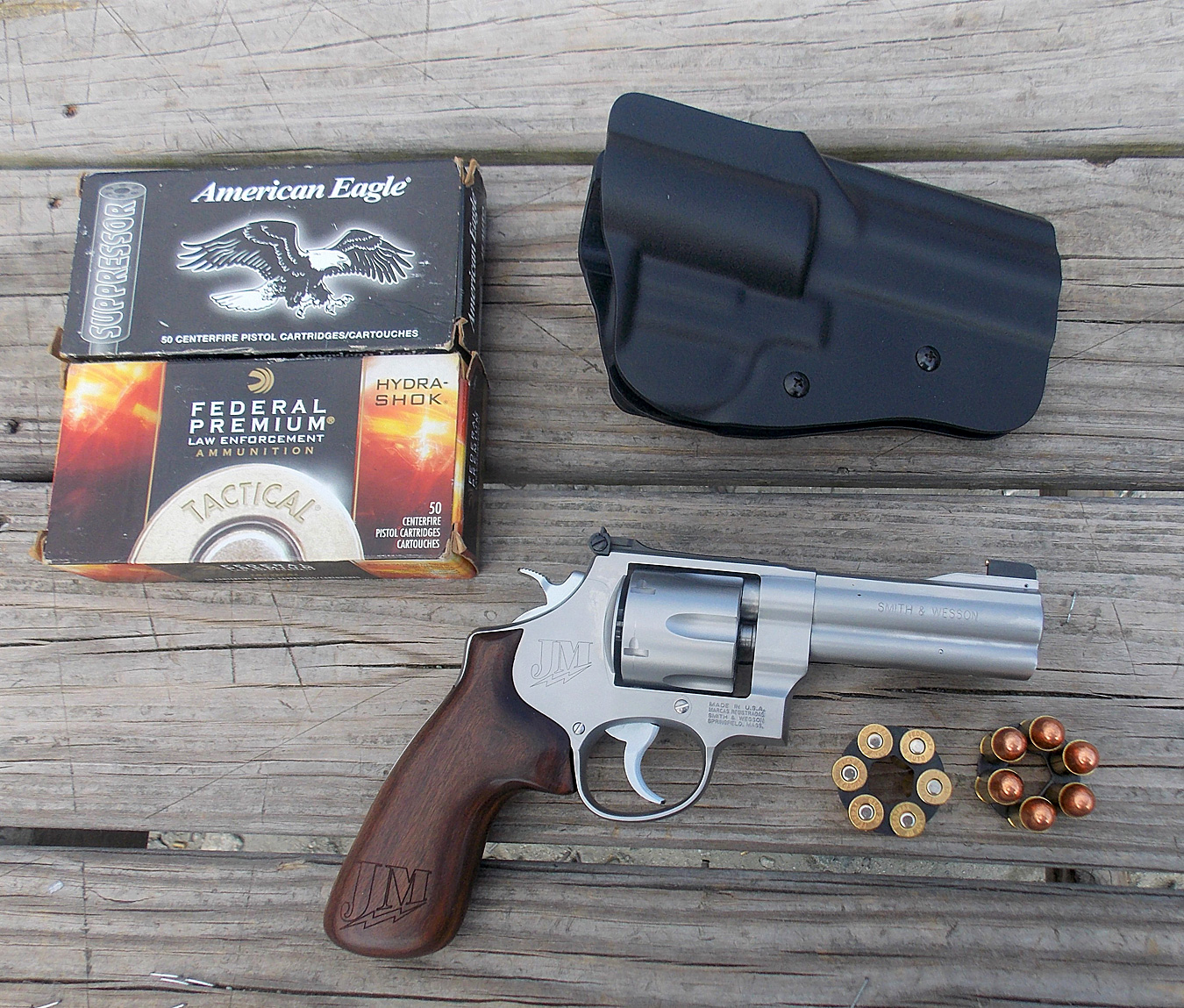 Smith and Wesson Model 625 JM revolver with ammunition and a holster