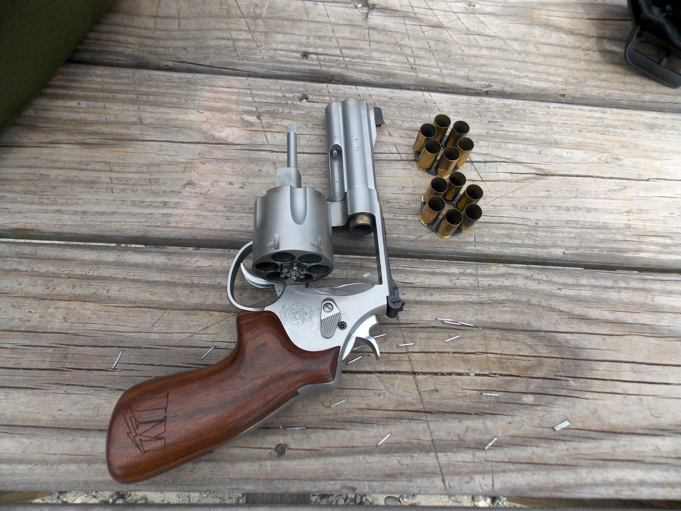 Smith and Wesson Model 625 JM with cylinder open with two moon clips filled with empty shells