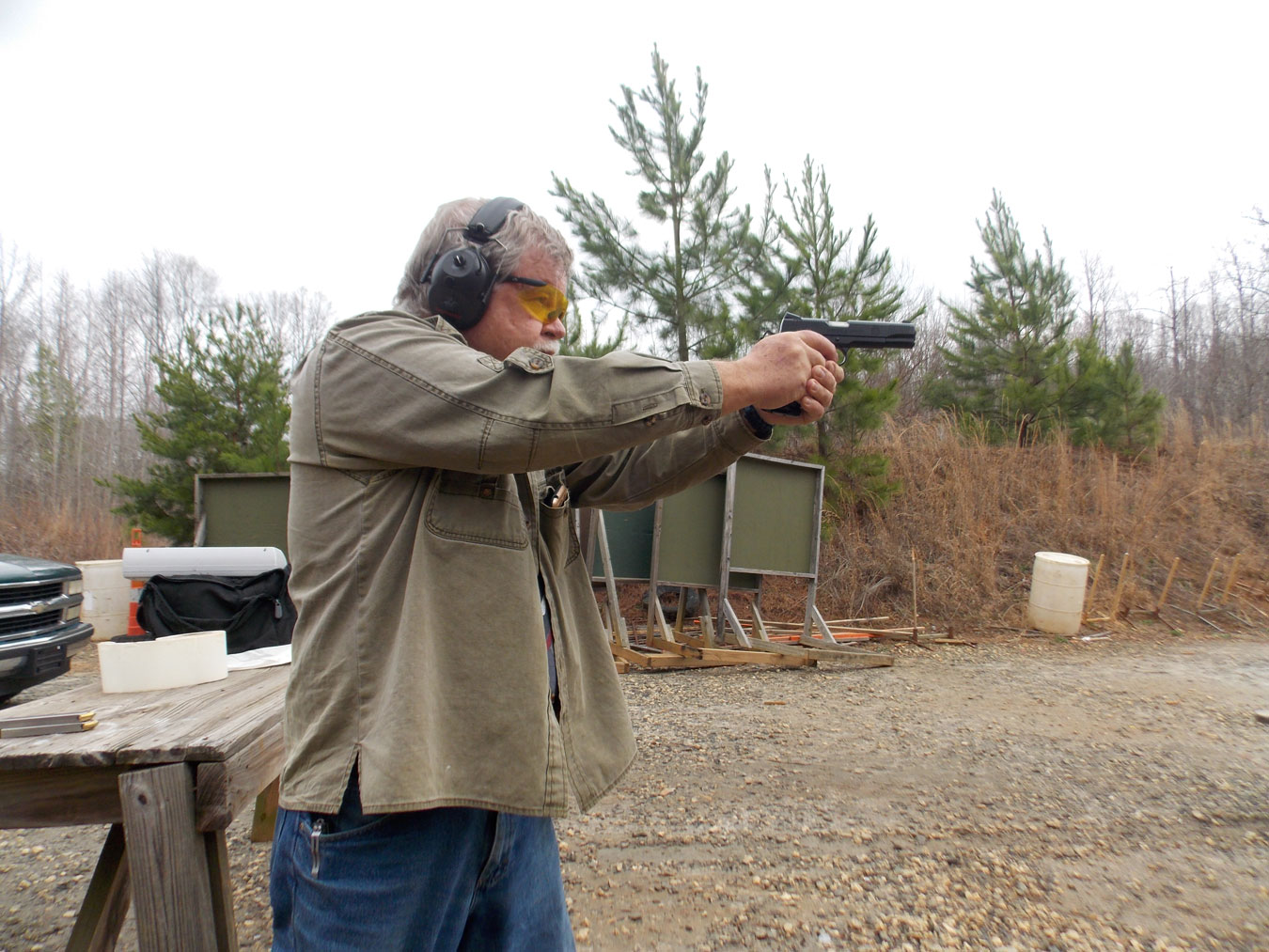 Bob Campbell shooting a Springfield TRP pistol with a two hand grip
