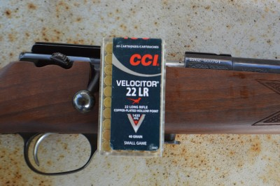 CCI .22 LR Velocitor ammunition box with bolt action rifle
