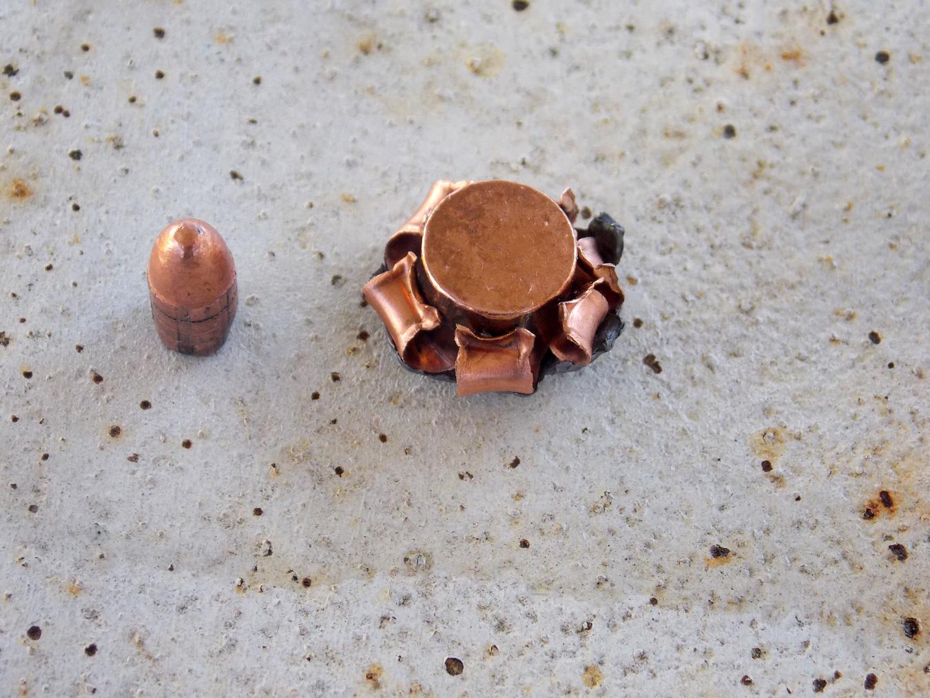 40-grain .22 LR bullet left,  upset .40 caliber JHP right