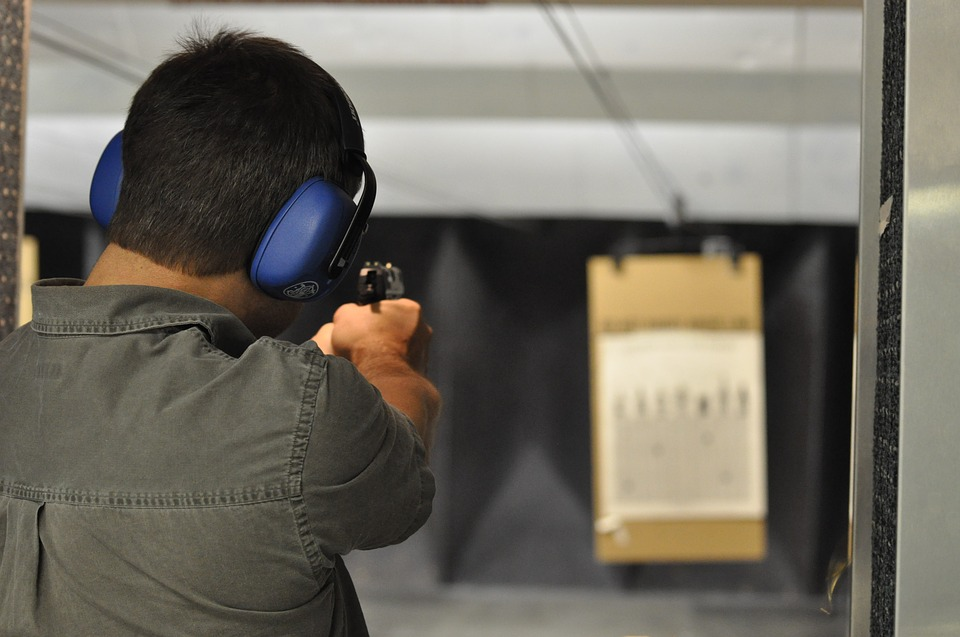 man shooting at an indoor range