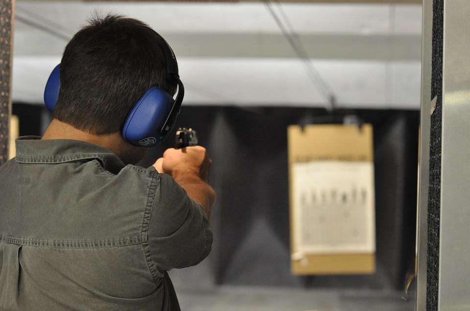 man shooting at an indoor range