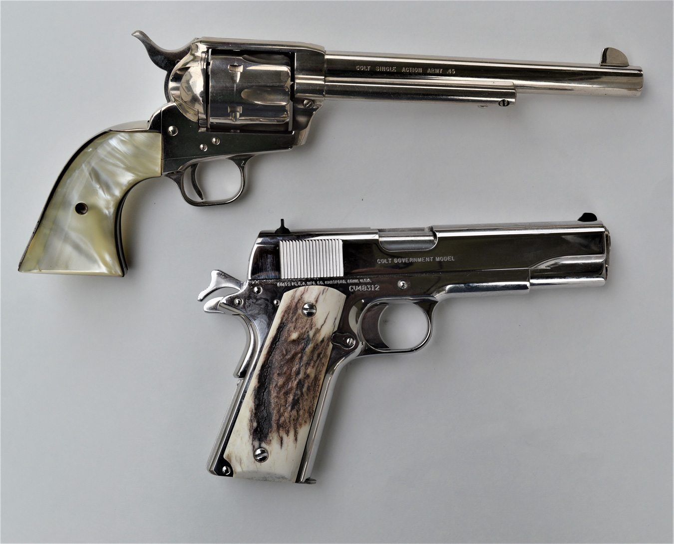Colt Single Action Army revolver and 1911 pistol with ivory grips