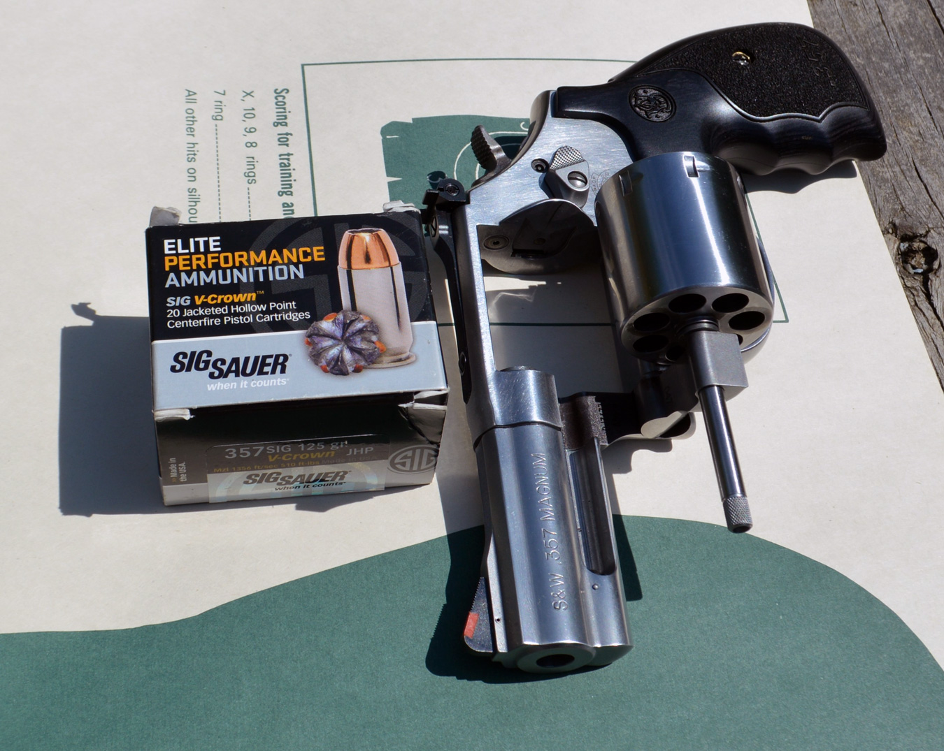 Smith and Wesson 686 plus revolver with open cylinder and SIG Sauer V-Crown ammunition box
