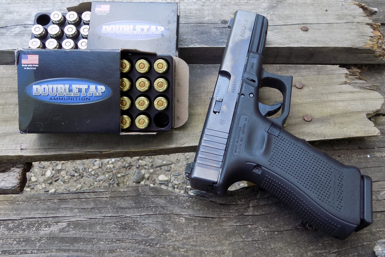 Glock 22 pistol with open box of Double Tap ammunition