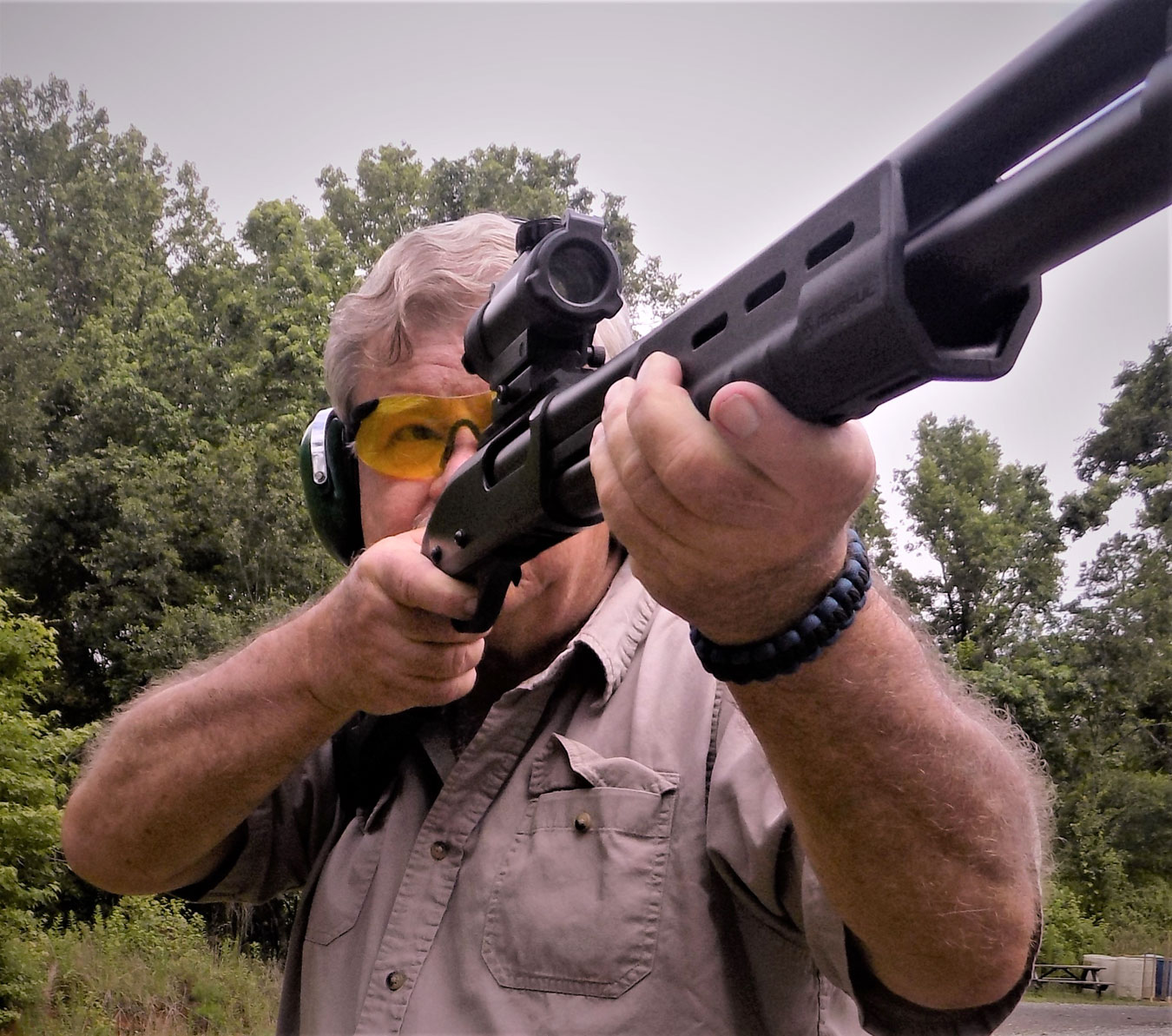 Bob Campbell shooting a shotgun with a red dot scope
