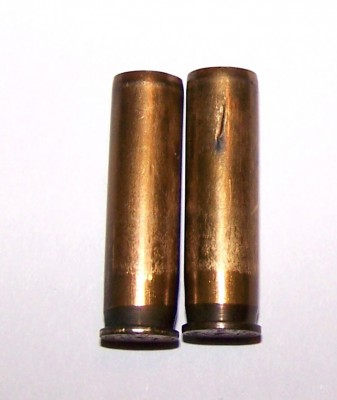 Two cartridge cases, one showing a crack