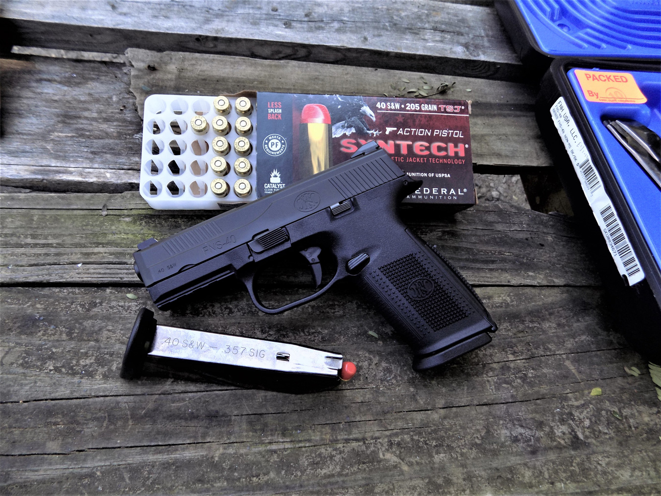 FNS 40 pistol atop a Syntech ammunition box