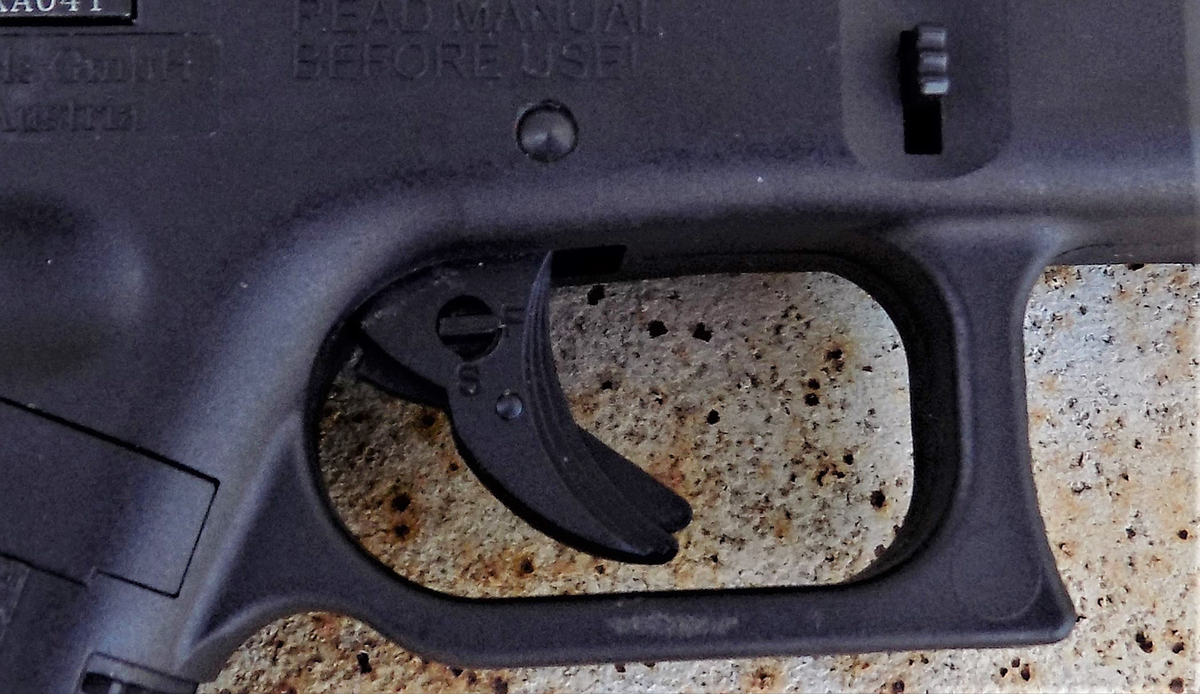 Unlocking the action on the ISSC M22 pistol