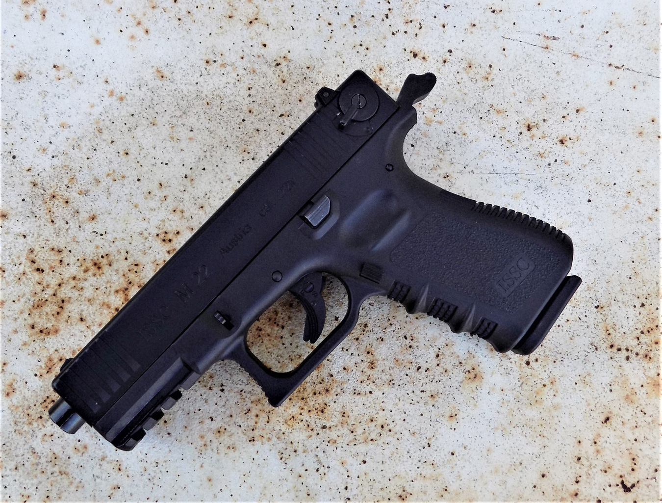 ISSC M22 pistol with the hammer cocked back