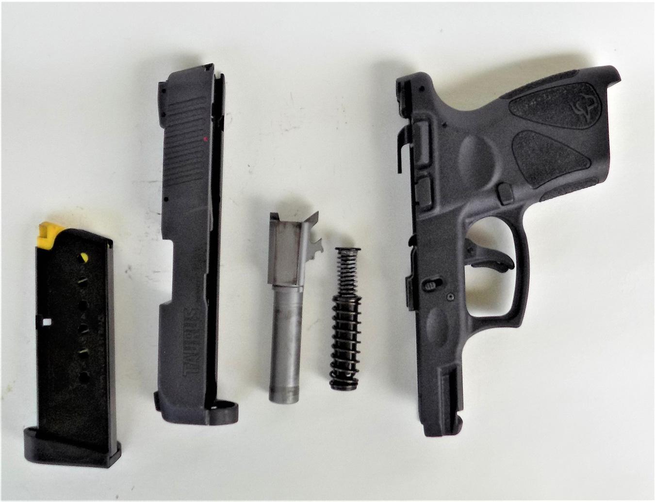 Field stripped Taurus Millennium pistol