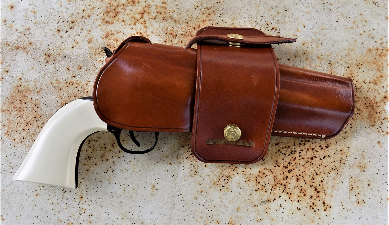 Bill Tilghman revolver in a leather holster