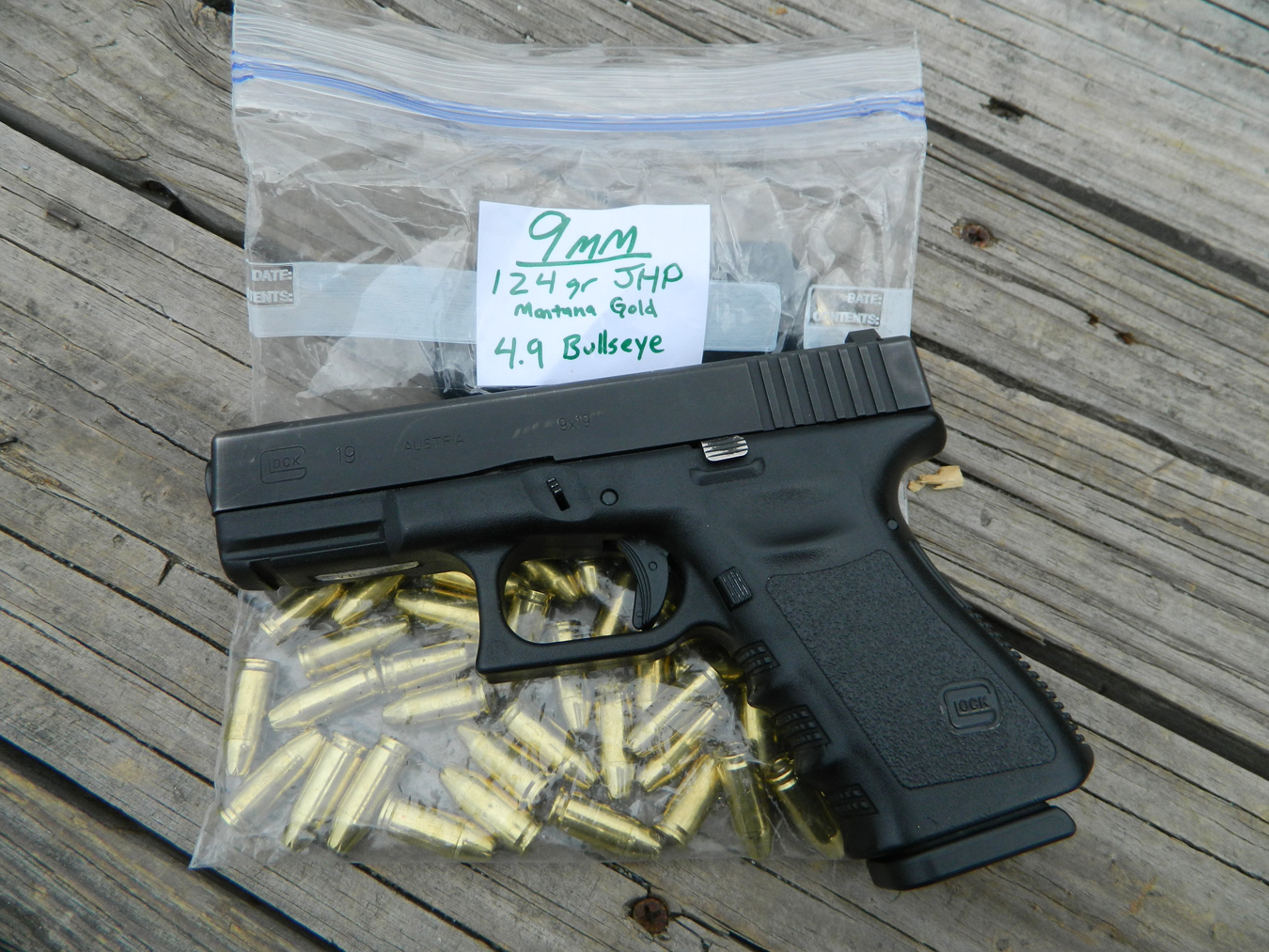 Glock 19 pistol on a Ziplock bag filled with ammunition