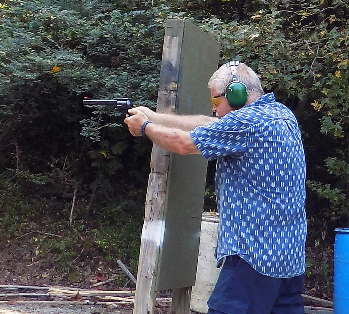 Bob Campbell shooting a .41 magnum revolver with a two-handed grip