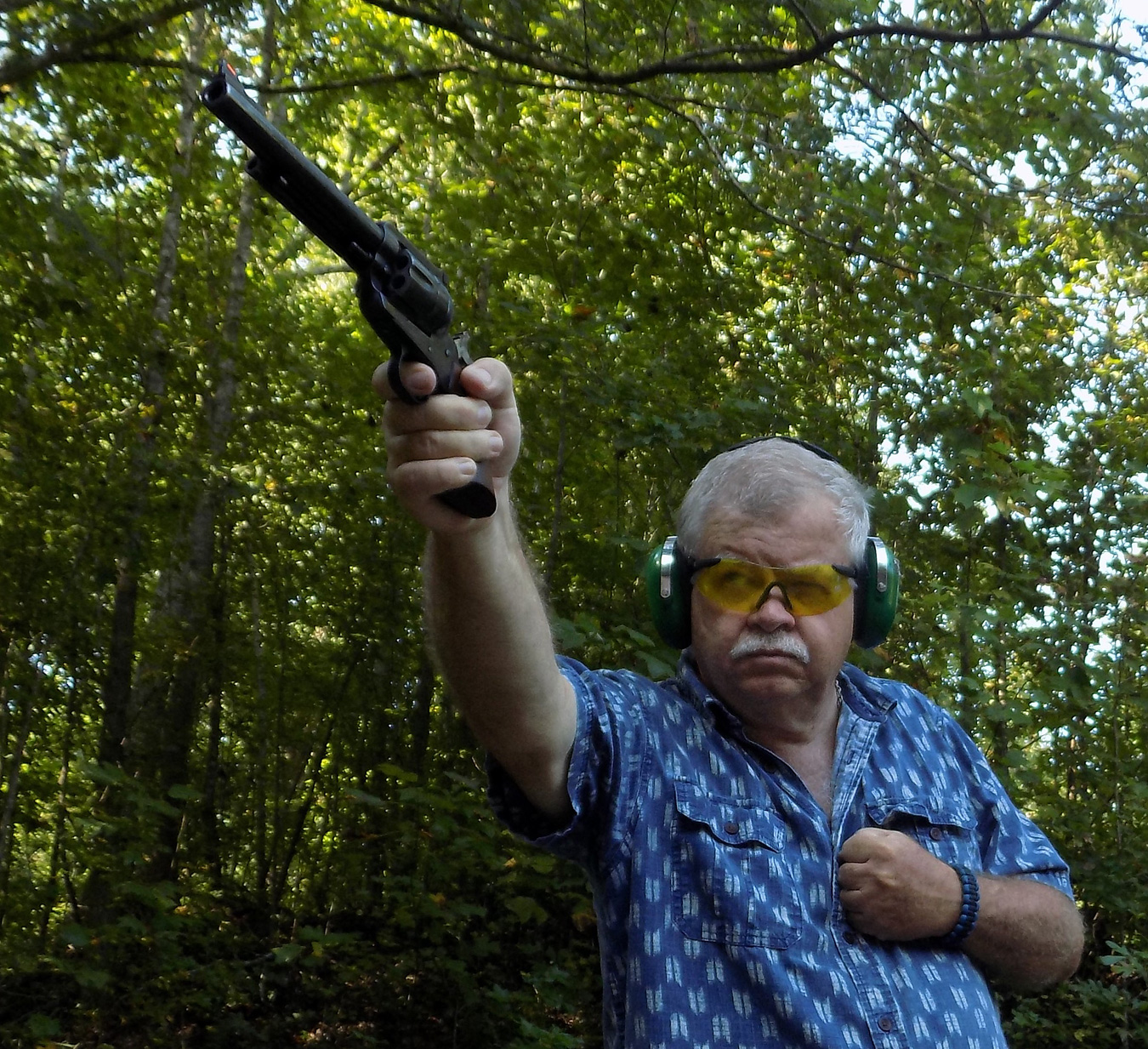 Bob Campbell shooting a .41 magnum revolver with a one-handed grip