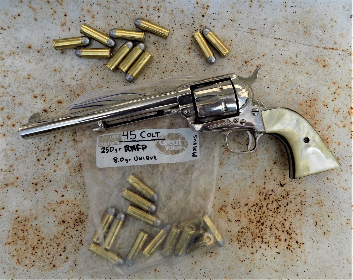 Colt Single Action Army  revolver with loose cartridges