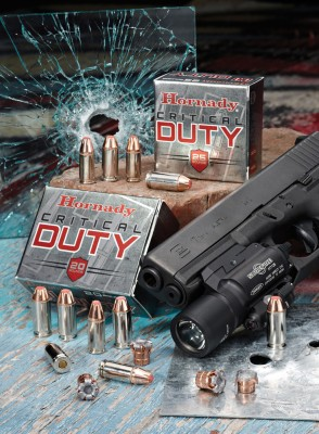 Hornady ammunition with car windshield with bullet hole