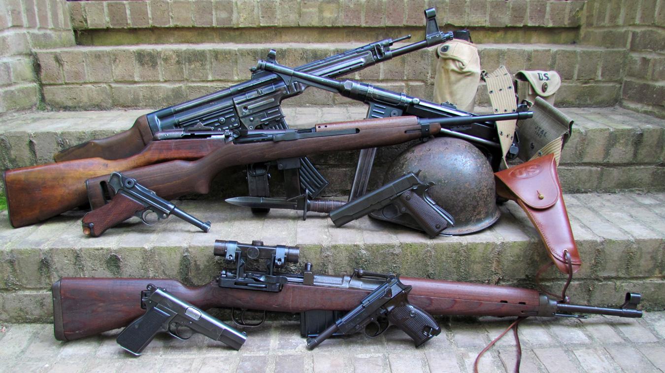 3 WWII vintage rifles with several vintage handguns