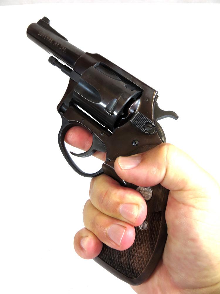 Man holding a revolver