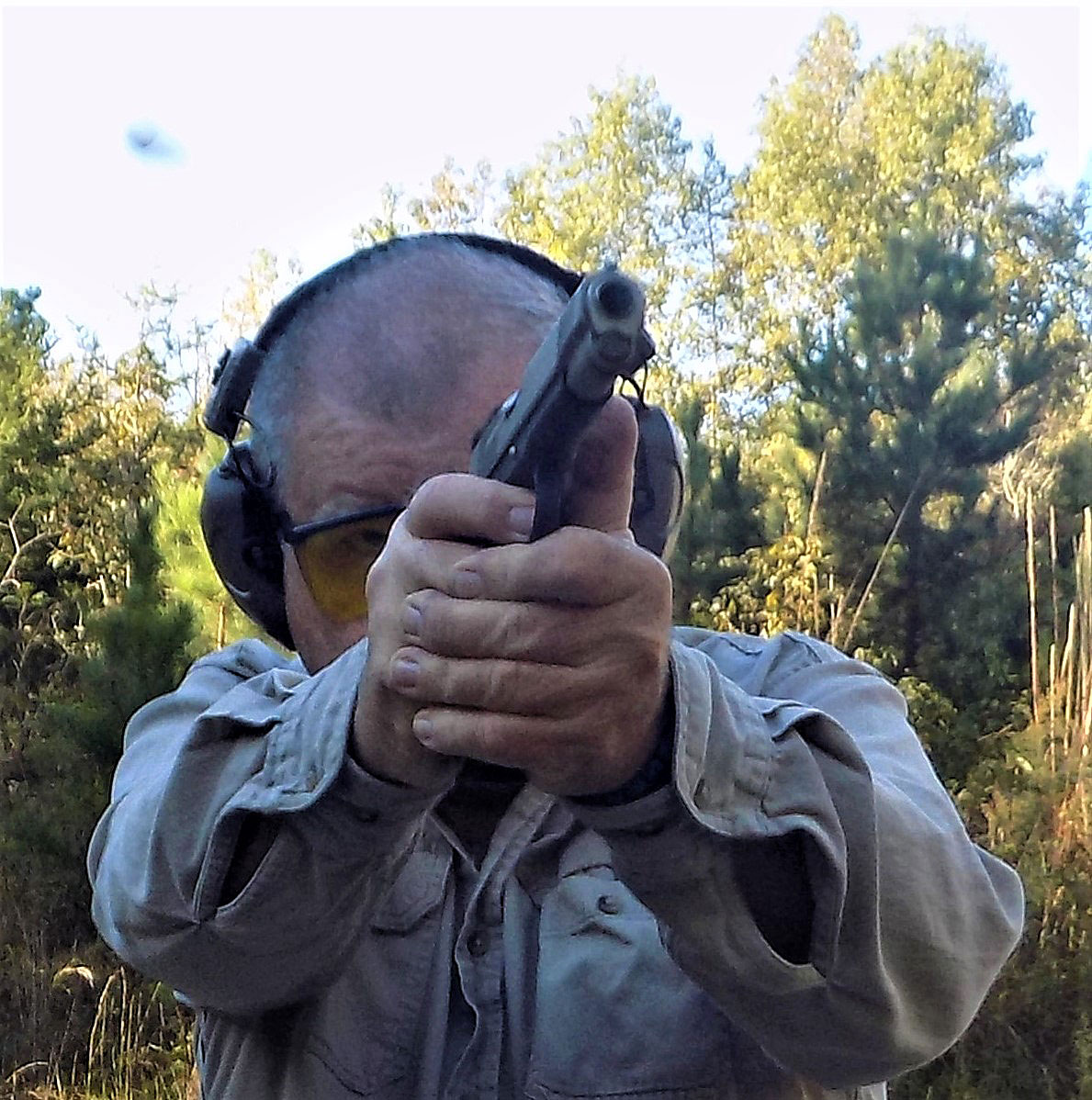 Bob Campbell controlling a 1911 pistol through recoil