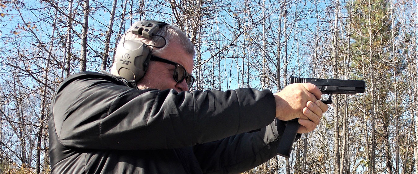 Bob Campbell shooting a Glock pistol with 33-round magazine