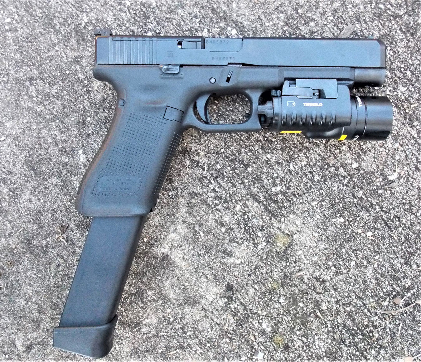 Glock 34 with 33-round magazine and TruGlo combat light