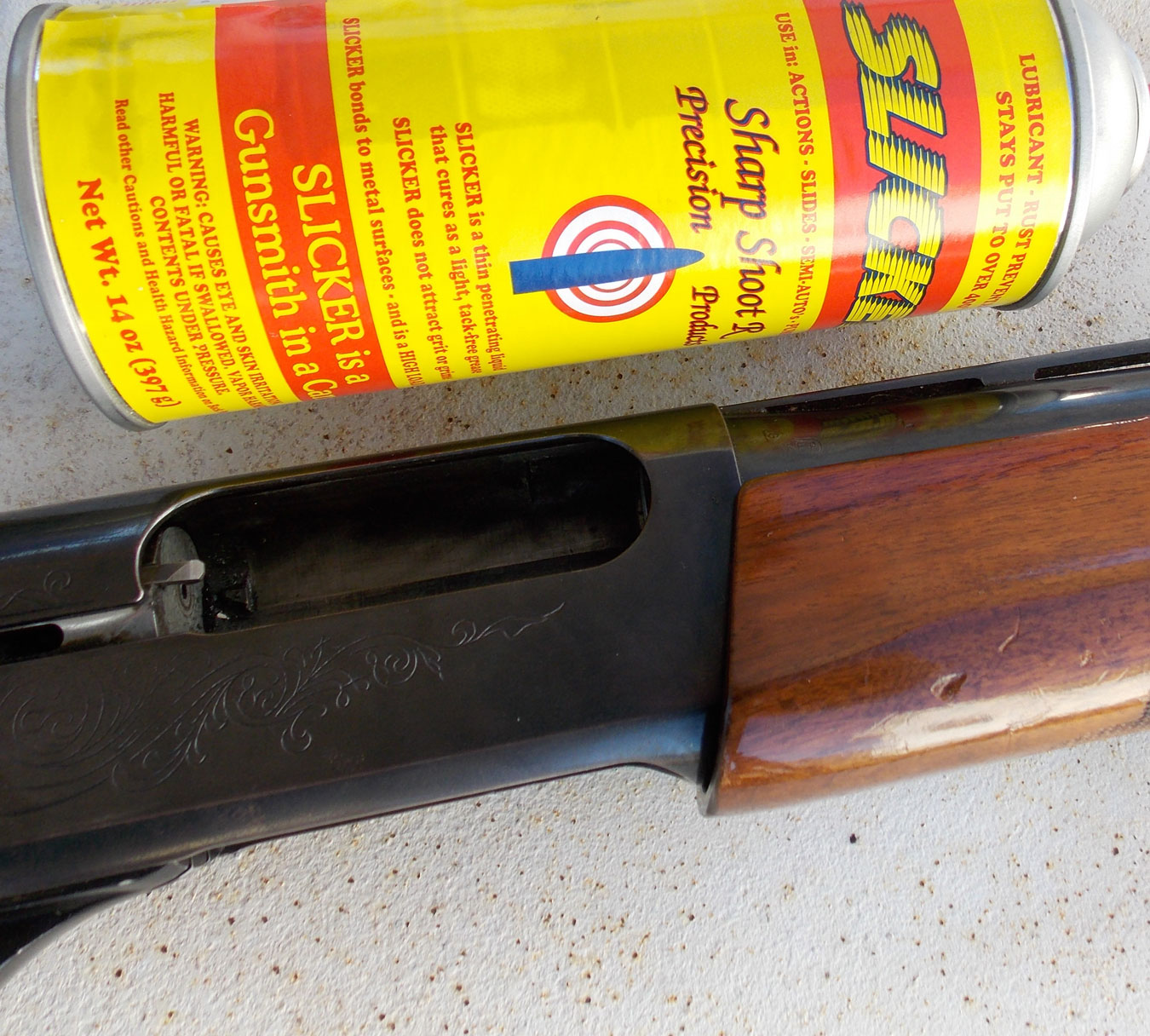 Remington 1100 shotgun and a can of spray lubricant