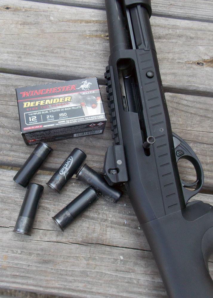 Black shotgun with Winchester PDX shotshells