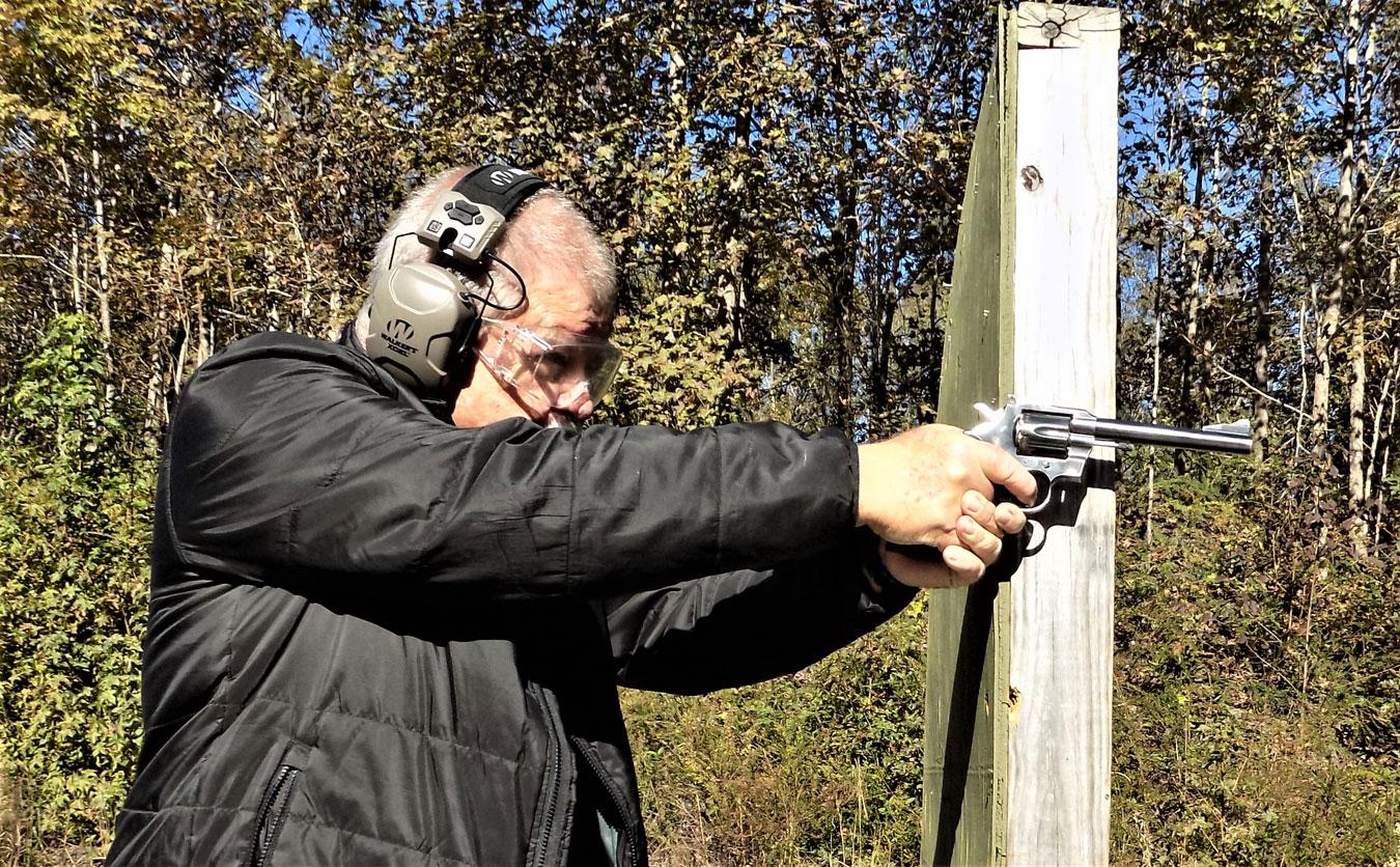 Bob Campbell shooting a Colt .357 revolver from a barricade