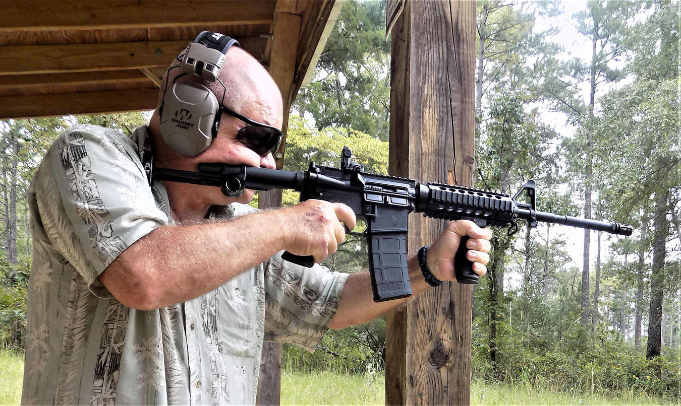 Bob Cambell shooting an AR-15 rifle with iron sights
