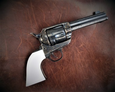 Traditions revolver with white grips and engraving