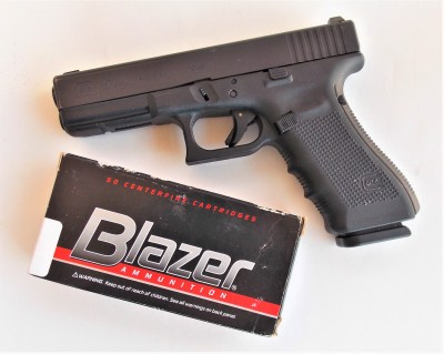 Blazer 9mm ammunition box with Glock pistol