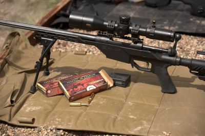 Savage rifle with bipod on a shooting mat