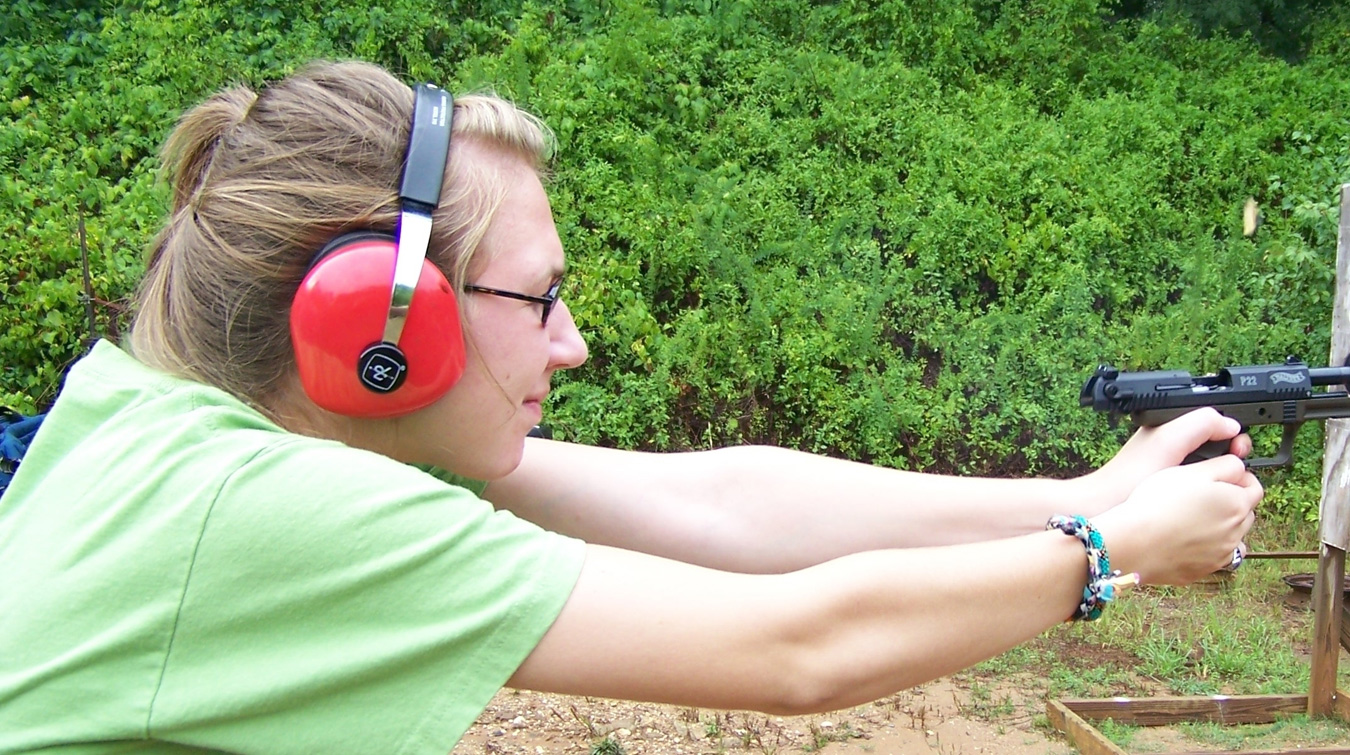 Woman shooting a .22 caliber pistol