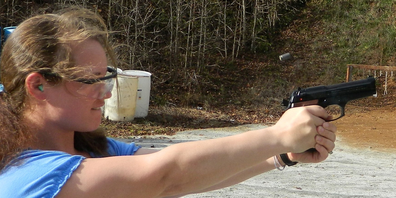 Emily Campbell shooting 9mm Beretta handgun