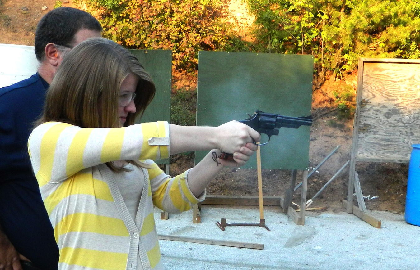 Woman shooting a revolver for the first time