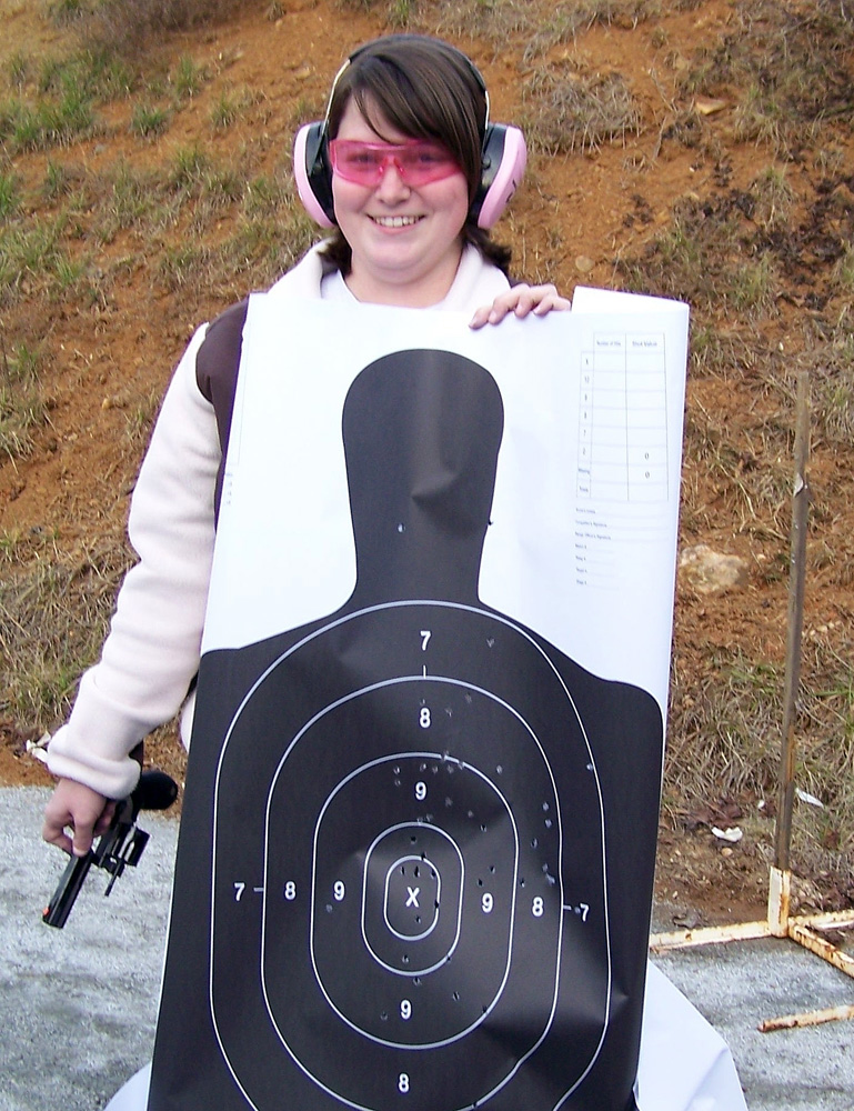 Woman holding a silhouette target