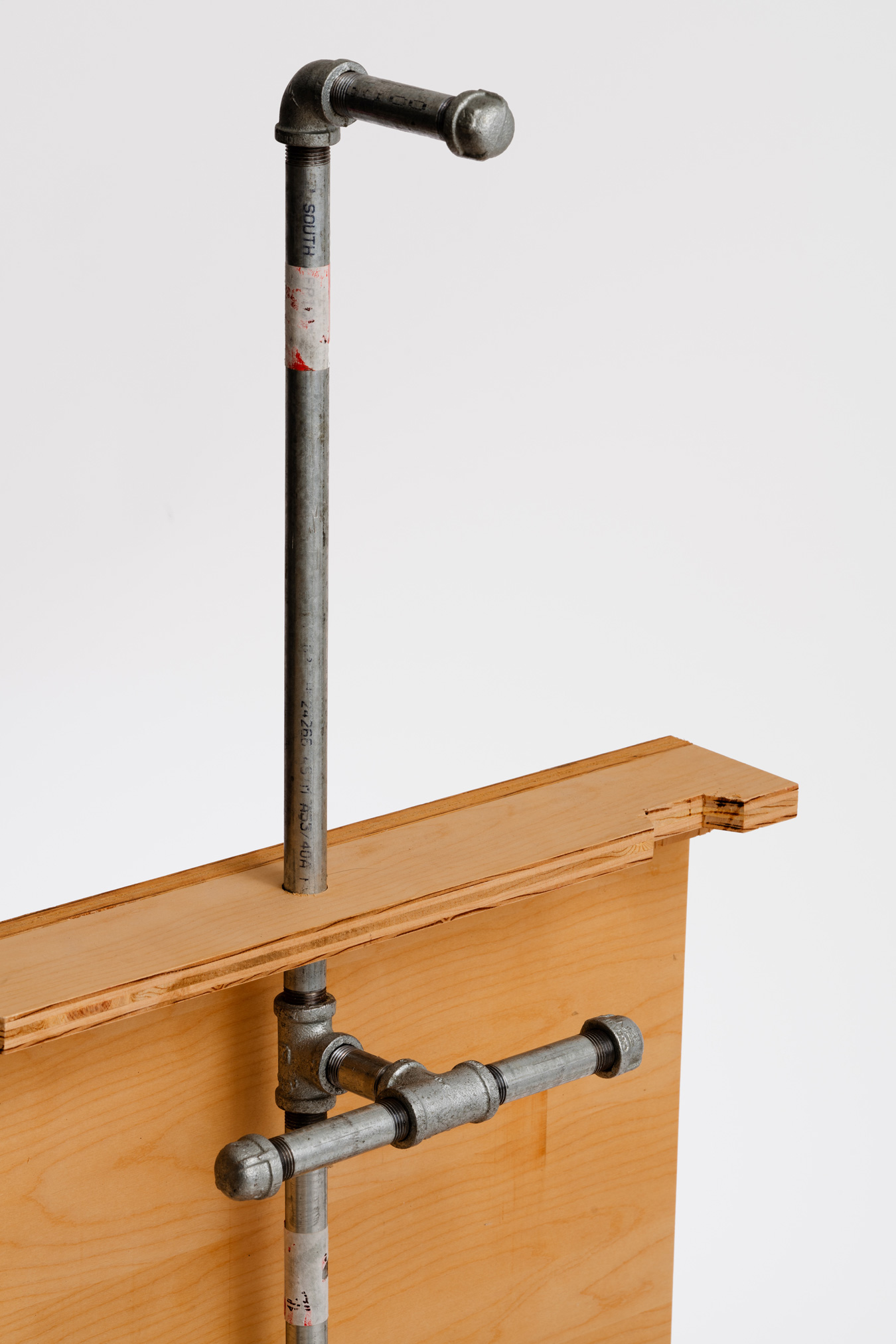 Wood box with back pipe tree