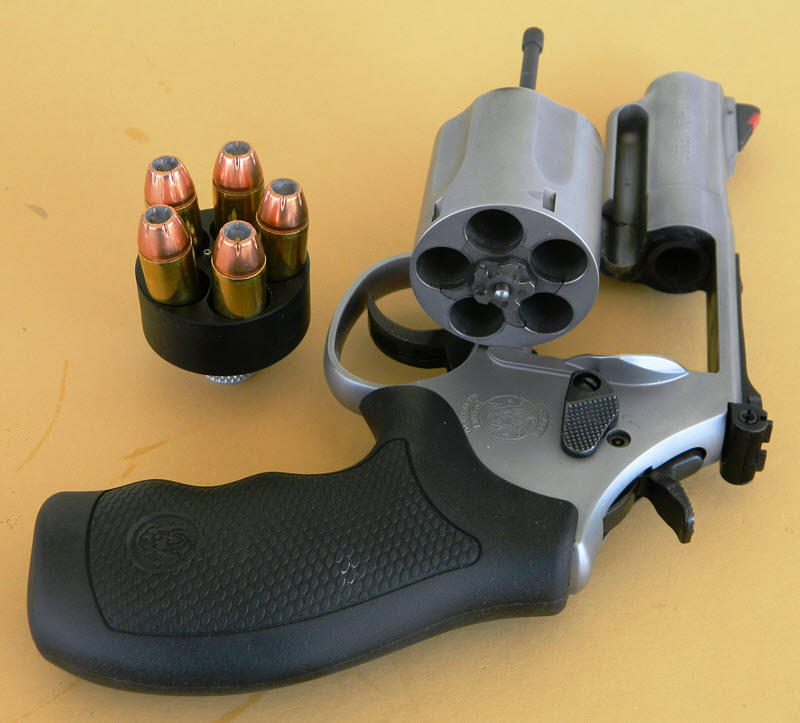 Smith and Wesson Model 69 Combat Magnum with open cylinder and HK speedloader.