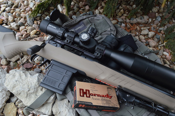 Savage 110 Tactical Desert 6.5 Creedmoor on a box of Hornady ammunition